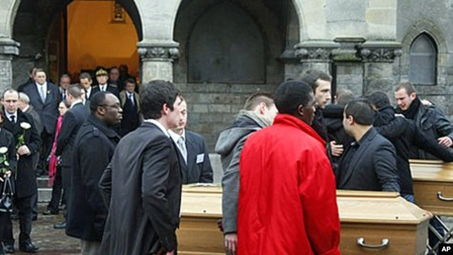 Relatives leave the funeral of Vincent Delory and Antoine De Leocour in Linselles, northern France, 17 Jan 2011