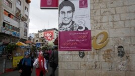A banner depicting Mohammed Assaf, a contestant in the TV talent show 'Arab Idol', is seen on a building in the West Bank city of Ramallah May 13, 2013.