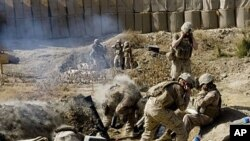 Marines of 2nd Battalion 2 Marines of 2nd Marine Expeditionary Brigade fire mortar rounds from their forward operating base in Mian Poshteh in Helmand Province, 23 Nov 2009