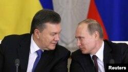 Віктор Янукович і Володимир Путін у грудні, 2013р.
