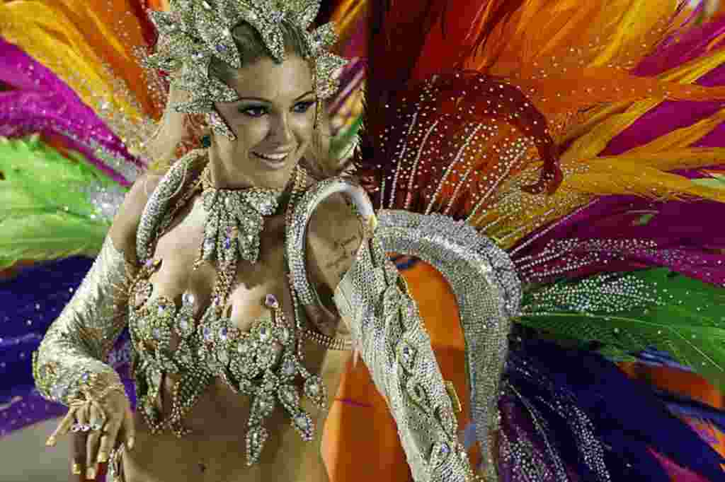 A dancer from Mocidade samba school parades during carnival celebrations at the Sambadrome in Rio de Janeiro, Brazil, February 20, 2012 (AP Photo)