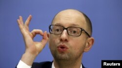 FILE - Ukrainian Prime Minister Arseny Yatseniuk gestures at a news conference in Kyiv, in this file picture taken December 30, 2014.