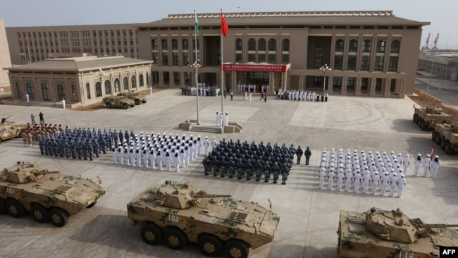 FILE - Chinese People's Liberation Army personnel attend the opening ceremony of China's new military base in Djibouti, Aug. 1, 2017.