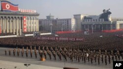Soldiers and citizens in Pyongyang, North Korea, on Tuesday protested a UN resolution condemning their country's human rights record. (AP Photo/Jon Chol Jin)