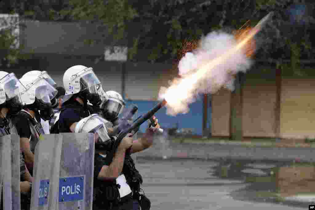 A Turkish policeman fires teargas during clashes that broke out to protest the death of Ahmet Atakan in Hatay, Turkey. Atakan, 23, died in Hatay after being hit in the head by a teargas canister shot by police during a an anti-government protest, the Atakan family said.