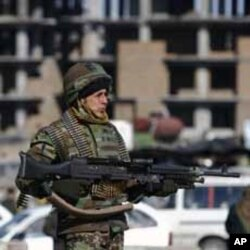 An Afghan National Army soldier keeps watch during clashes with protesters in Kabul.