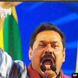 President Rajapaksa, behind bulletproof glass, addressing supporters, 24 Jan 2010