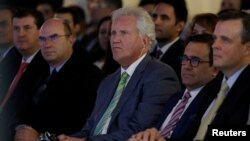 General Electric Co. Chief Executive Jeff Immelt (center) and Mexican Economy Minister Ildefonso Guajardo (second right) attend the opening of a new tower of the Global Operations Center in San Pedro Garza Garcia, neighboring Monterrey, Mexico, May 12, 2017.