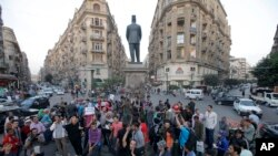 Egyptian protesters chant slogans in Talaat Harb Square in Cairo, Egypt, against the issuance of a new law regulating demonstrations, Thursday, Nov. 28, 2013.