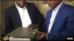 FILE - Haitian senators hold a copy of the final PetroCaribe corruption report in Port au Prince, Haiti, May 31, 2019. (M. Vilme/VOA)