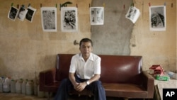Youk Chhang, head of the Documentation Center of Cambodia (DC-CAM), in Tuol Sleng school, a former Khmer Rouge interrogation center turned into a museum, where many of the documents he is researching still are stored.