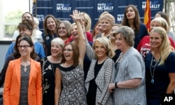Rep. Martha McSally, R-Ariz., third from left, at a campaign event, Aug. 15, 2018, in Phoenix.