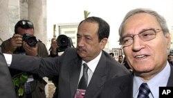 Syrian Vice President Farouk al-Sharaa, right (file photo)