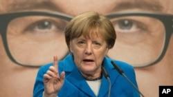 德国总理默克尔2016年3月8日在一次竞选集会上发表演说