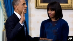 President Obama takes the oath of office at the official swearing-in ceremony in the Blue Room of the White House, January 20, 2013.