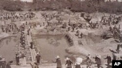 """Cambodians working on an irrigation project. Dam """"January 1st,"""" Chinith River, Kampong Thom province, 1976."""