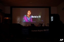 A portrait of a girl who was married at age 16 is shown in a presentation by New York-based Human Rights Watch during the release of a report on child marriage in Nepal in Kathmandu, Nepal, Sept. 8, 2016.