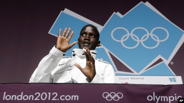 Marathon runner Guor Marial, who is stateless, appears during a news conference at the 2012 Summer Olympics, in London, August 10, 2012.