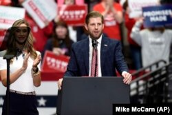 Eric Trump, son of President Donald Trump, speaks during a campaign rally as his wife, Lara watches in Charlotte, N.C., Monday, March 2, 2020. (AP Photo/Mike McCarn)