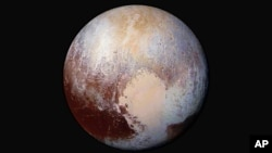 Hills of water ice on Pluto 'float' in a sea of frozen nitrogen and move over time like icebergs in Earth's Arctic Ocean—another example of Pluto's fascinating geological activity. The New Horizons spacecraft passed Pluto in July of 2015.