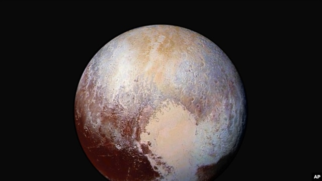 FILE - A journey to Pluto reveals a close-up view of mountains of water in frozen fields of nitrogen and methane.
