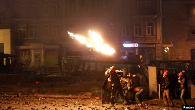 Pro-European protesters throw petrol bombs during clashes with Ukranian riot police in Kyiv, Jan. 20, 2014.