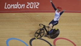 Britain's Jason Kenny celebrates after winning the gold medal in the track cycling men's sprint event, during the 2012 Summer Olympics in London, Monday, Aug. 6, 2012.