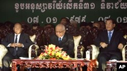 Chea Sim, center, president of the ruling Cambodian People's Party, Hun Sen, right, the party's vice president and also Cambodian prime minister, and Heng Samrin, left, the party's honorary president, sit as the country marks Khmer Rouge downfall in 1979,