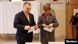 Current Hungarian Prime Minister Viktor Orban and his wife Aniko Levai vote during Hungarian parliamentary election in Budapest, Hungary, Apr. 8, 2018.