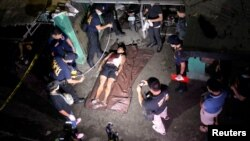 """The body of a man whom police said was killed during a drug bust operation on """"Shabu"""" (Meth), is seen in Manila, Philippines, Aug. 18, 2016."""