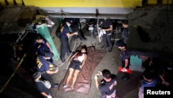 "FILE - The body of a man who police said was killed during a drug bust operation on ""shabu"" (meth) is seen in Manila, Philippines, August 18, 2016."