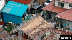 Houses damaged by an earthquake are seen in Kurayoshi, Tottori prefecture, Japan in this photo released by Kyoto, Oct. 21, 2016.