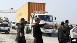 Pakistani security personnel stop truck carrying supplies for NATO forces in neighboring Afghanistan at Takhtabeg check post in Pakistani tribal area of Khyber, Pakistan, on their way to Torkham border post on Saturday, November 26, 2011.
