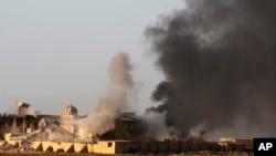 تکریت پر عراقی فوج کی بمباری کے بعد کا ایک منظر