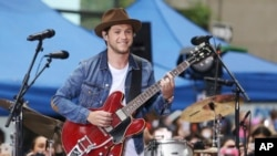 "FILE - In this May 29, 2017, file photo, singer Niall Horan performs on NBC's ""Today"" show in New York. Horan will join Ariana Grande at a charity concert called ""One Love Manchester"" in Manchester, England, June 3, 2017."