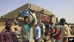 Shaidu a gidan dake Kano sun ce jami'an tsaro sun kashe wani mutum da mace mai ciki lokacin da suke farautar membobin kungiyar Boko Haram.