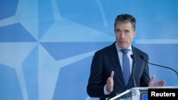 NATO Secretary-General Anders Fogh Rasmussen holds a news conference at the Alliance's headquarters in Brussels April 16, 2014.