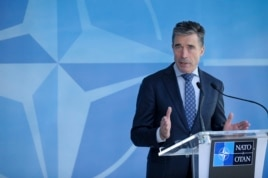 FILE - NATO Secretary-General Anders Fogh Rasmussen holds a news conference at the Alliance's headquarters in Brussels, Apr. 16, 2014.