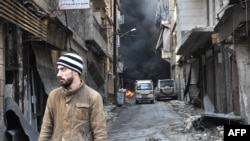 FRILE - A Syrian man walks through the former rebel-held Salaheddin district in the northern Syrian city of Aleppo.