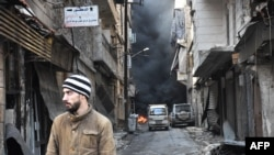 A Syrian man walks through the former rebel-held Salaheddin district in the northern Syrian city of Aleppo, Dec. 23, 2016.