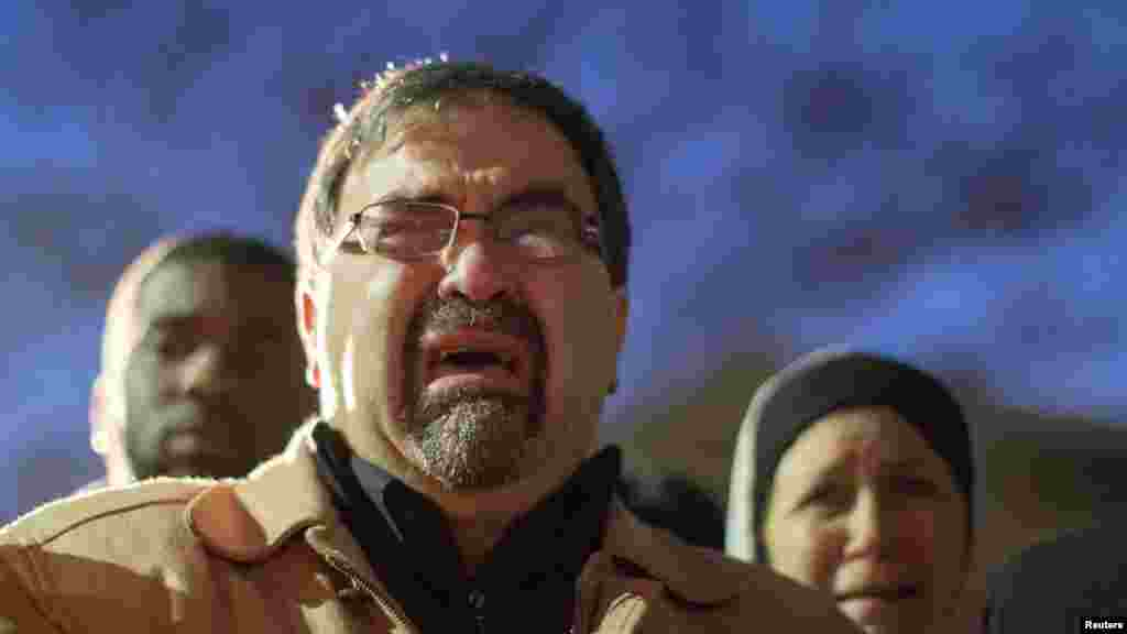 Namee Barakat, father of shooting victim Deah Shaddy Barakat, cries as a video is played during a vigil on the campus of the University of North Carolina in Chapel Hill, N.C., Feb. 11, 2015.