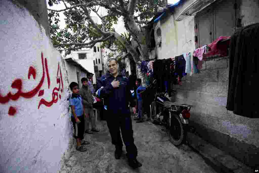 Released Palestinian prisoner Omar Masoud, who was arrested in May 1993 for killing an Israeli lawyer, walks in the alley of his neighborhood after spending 20 years in an Israeli jail, Shati Refugee Camp, Gaza City, Oct. 30, 2013.