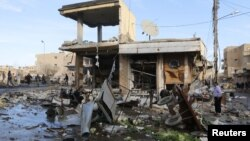 A site hit by what activists said were airstrikes by forces loyal to Syria's President Bashar al-Assad is pictured in Raqqa, Syria, Nov. 25, 2014.