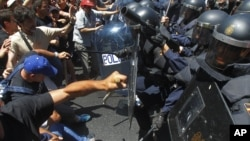Demonstrators clash with riot police during a coal miner's march to the Spanish capital, Madrid, July 11, 2012.