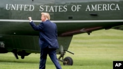 FILE - President Donald Trump walks on the South Lawn of the White House in Washington, May 8, 2019, to board Marine One.