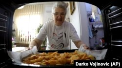 Granny Jela shows millions how to cook online