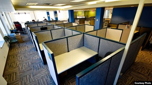 Things are pretty quiet in this small cubicle farm in Portland, Oregon - but only because no one's working there right now.  (Asa Wilson, Wikipedia Commons)