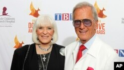 FILE - Shirley and Pat Boone arrive at Lipscomb University for the Dove Awards, Oct. 7, 2014, in Nashville, Tenn.