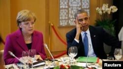 """Обама та Меркель під час саміту """"Великої сімки"""" в Брюсселі, 4 червня 2014 р."""