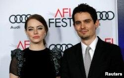 "Director Damien Chazelle and cast member Emma Stone pose at the premiere of ""La La Land"" during AFI FEST in Hollywood, Calif., Nov. 15, 2016."